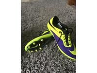 Nike football boots moulded hard ground.