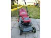 Petrol lawnmower / grass cutter