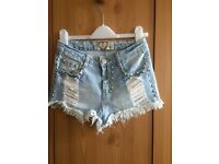 Distressed hotpants, size 6