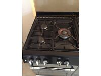 Good condition 7 gas range , ignition, fan assisted oven,conventional oven and separate clean grill.