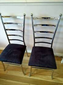 Two silver and black chairs