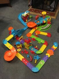 Massive bundle of v tech toot toot track, garage, 8 cars, fire station carry case,