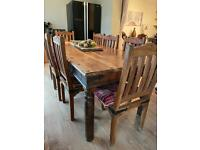 Large wooden table and chairs