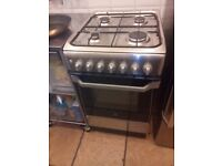 Indesit Freestanding cooker with gas hobs and electric oven.