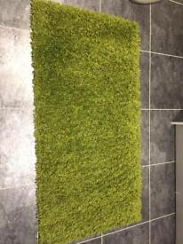2x identical green rugs, size 5ft x 2ft8 each, excellent condition, smoke and pet free house