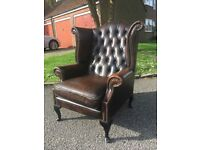 Leather chesterfield wing-back armchair