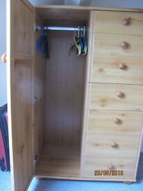 Small compact pine wardrobe with drawers, perfect for child's room or loft space with low ceiling.