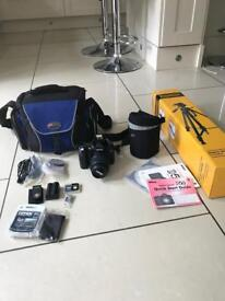 Nikon D50 DSLR - stock lens, bag, tripod 2 haze filters, remote control, 2 batteries