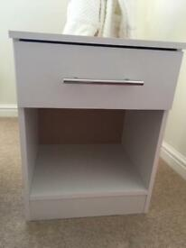 2 white bedside tables