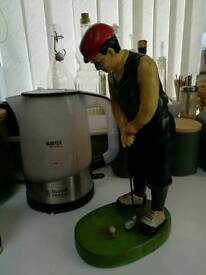 Vintage man golfer statute