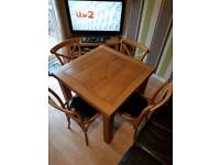 Solid oak adjustable dinning table and chairs
