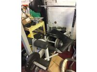 Weight lifting bench weights and bar good condition must be picked up