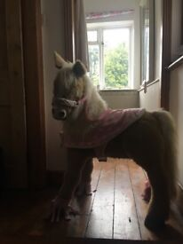 Beige moving electric pony