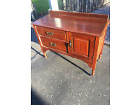Older style small sideboard unit with 2 drawers and cupboard on caster wheels