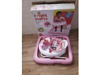 Bright starts baby walker, pink in colour. new condition.