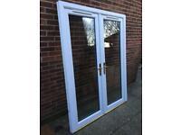 Anglian UPVC White French Doors low aluminium threshold
