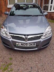 silver 4 door Vauxhall Astra Eco Flex Life