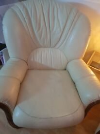 Cream leather sofa and two arm chairs