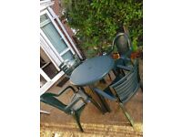 Outdoor green table with 4 chairs