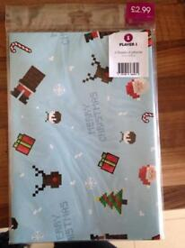 3 brand new packs of wrapping paper from Game ( free )