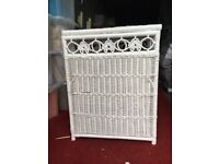 White wicker linen basket