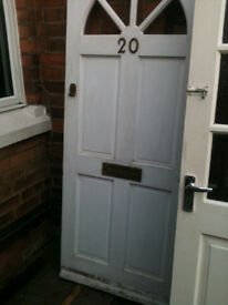Exterior wooden door with clear half circle glass