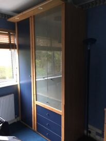 Bedroom cupboard with integral lighting and matching chest of drawn