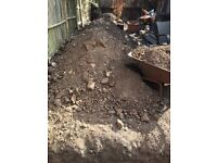 FREE top soil mixed with chunks of stone and rubble.