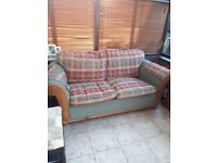 2 seater Sofa bed. Green and red. Metal framed pull out bed.
