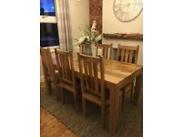 Solid wooden dining table with six chairs (excellent condition)