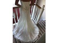 Never used ETERNITY lace wedding dress.