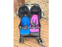 Joie double buggy with raincover.