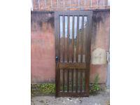 Hardwood Glazed Exterior Door with lock handles and hinges. 32in x78in