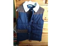 A bundle of boys clothes made up of 5 t-shirts, a gilet and a hoodie, Next, M&S, M&Co and Tu.