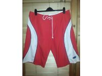 Red NOMAD Surf Shorts