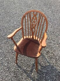 Light oak wheel back armchair