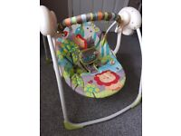 Swinging baby chair, used twice. Different speed settings, unisex colours