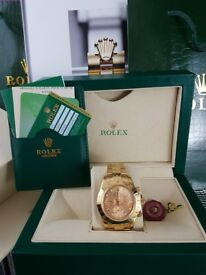 Gold Rolex Daytona, gold Face. Comes Rolex Bagged, Boxed with Paperwork