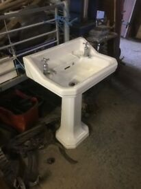 Antique sink and pedestal complete with taps