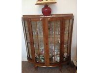 Vintage bow front wooden china cabinet