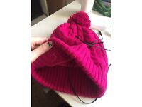 Pink beanie with incorporated headphones