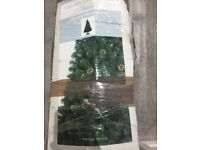 6 foot Christmas tree, decorations and stockings