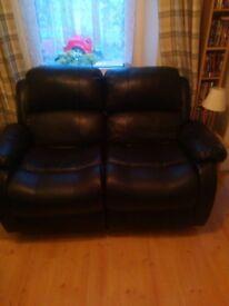 2 black two seater sofas