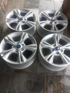 BRAND NEW NEVER MOUNTED FORD  FOCUS  FACTORY OEM  16 INCH ALLOY WHEEL SET OF FOUR.  NO SENSORS.