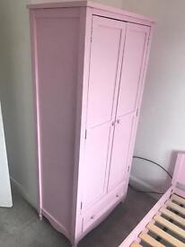 Pink childrens bed and wardrobe