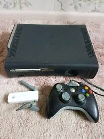Xbox 360 with 22 games and wireless adaptor in very good condition