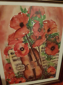 Framed painting of red flowers