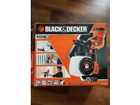 Spray gun Black &Decker Never used with all the parts in box.Fine spray system ,hand held.