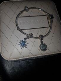 Pandora braclet nice new not bin worn in loveley box wth 2 charms