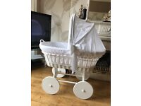 Large white wicker crib with wheels